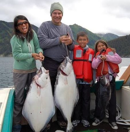family fishing for halibut
